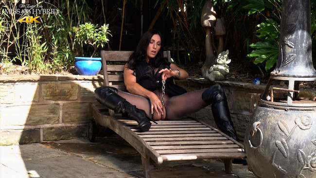 Miss Hybrid spunky tits and thigh boots in the garden.