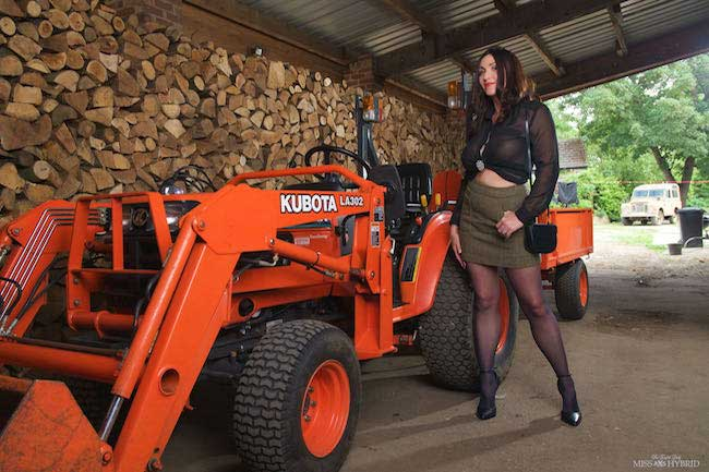 Miss Hybrid big tits wood inspector on the tractor in stockings and heels.