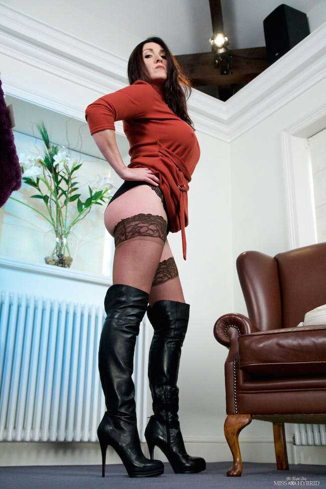 Miss Hybrid leather boots, stockings and glass dildo.