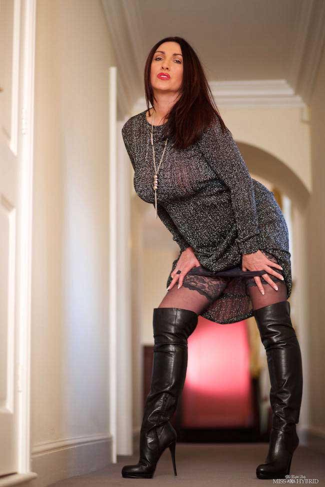 Mistress Miss Hybrid watching you as she keeps you captive.