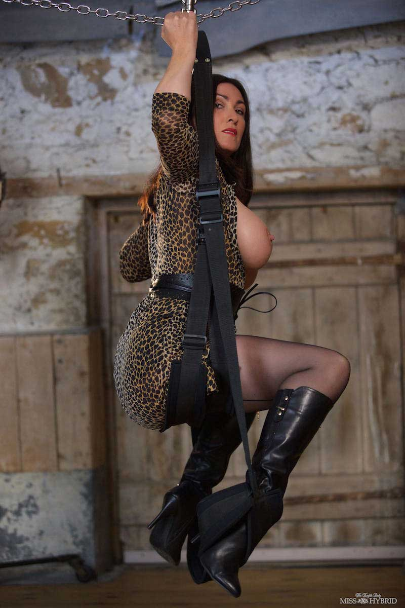 Knee high boots, Miss Hybrid tits out playing with her Magic Wand.