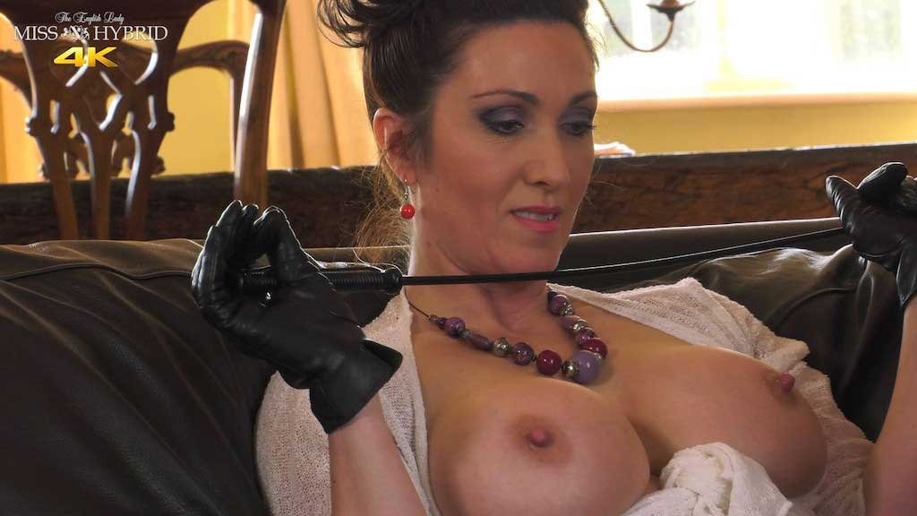 Miss Hybrid strict boss, tits out, leather gloves and magic wand.