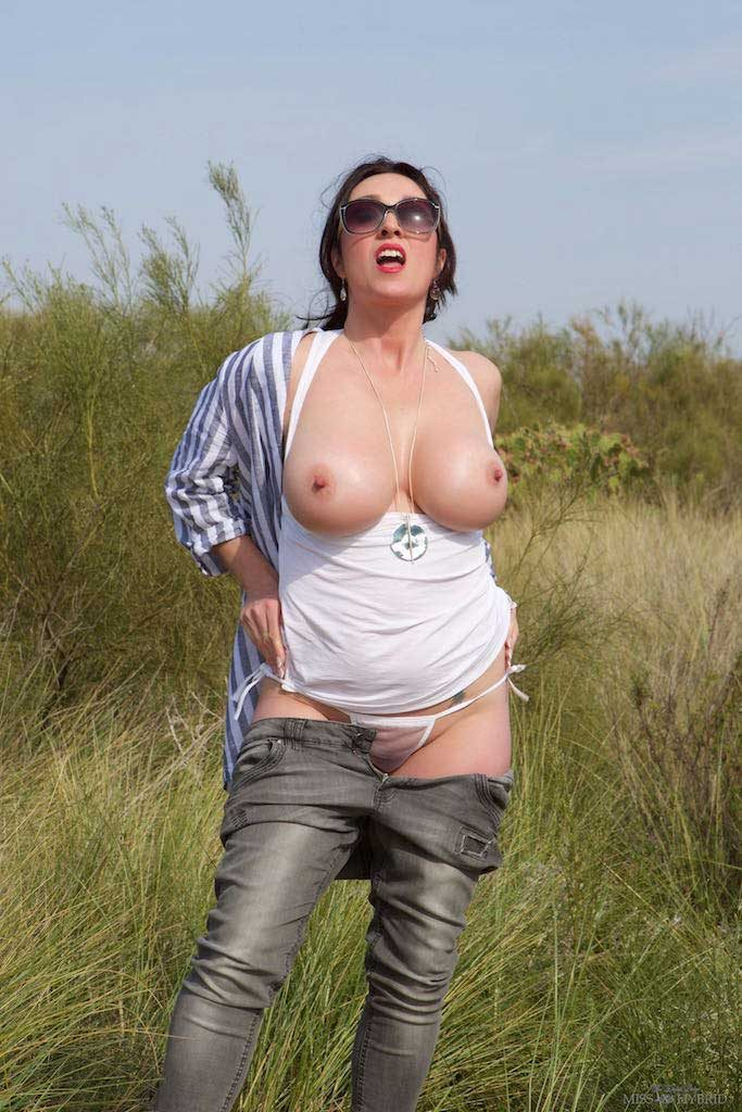 Miss Hybrid huge tits and hard nipples in the dunes.