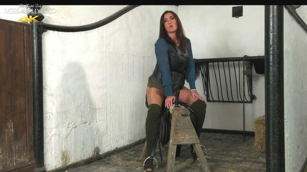 Miss Hybrid leather and boots saddling up to ride cock.