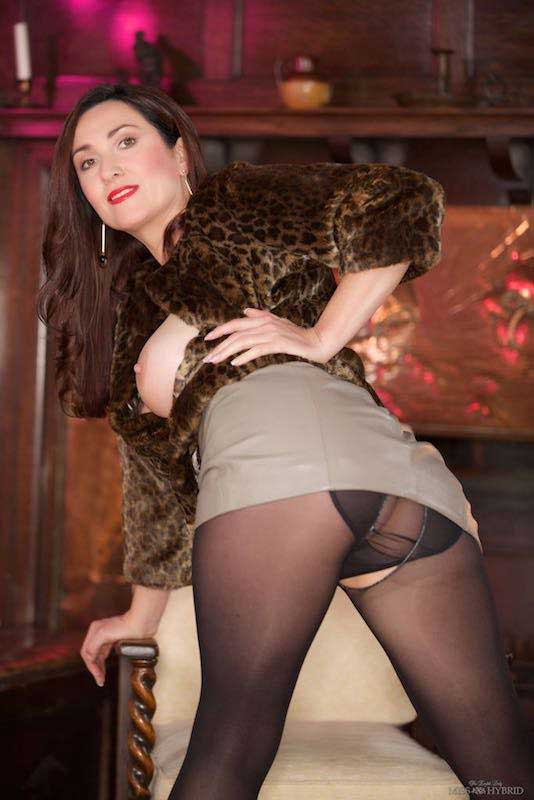 Miss Hybrid fur coat and big tits, leather skirt and nylons.